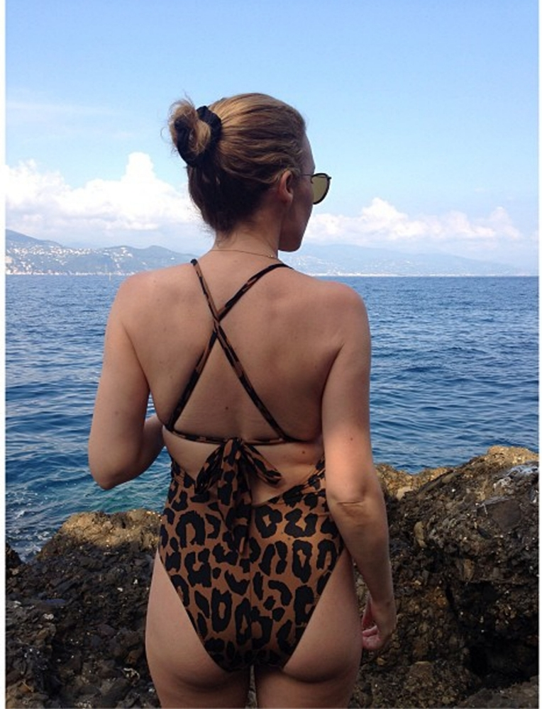 Kylie Minogue flaunts her famous bum in leopard print swimsuit