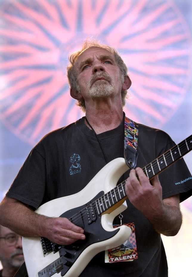 """FILE - In this June 5, 2004 file photo, singer-songwriter J.J. Cale plays during the Eric Clapton Crossroads Guitar Festival in Dallas, Texas. Cale, whose best-known songs became hits for Eric Clapton with """"After Midnight"""" and Lynyrd Skynyrd with """"Call Me the Breeze,"""" has died. He was 74. Caleís manager Mike Kappus said the architect of the Tulsa Sound died Friday, July 26, 2013 of a heart attack at Scripps Hospital in La Jolla, Calif. (AP Photo/Tony Gutierrez, File)"""