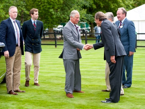 Polo crowd congratulates Prince Charles on birth of grandson George in surprise walkabout at match