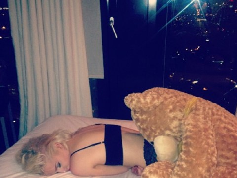 Helen Flanagan flops out on her bed as she moves into new Manchester pad