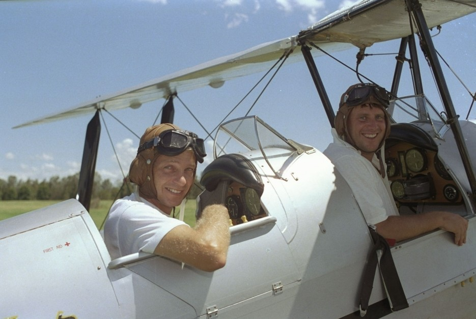 """David Gower and John Morris prepare to take the infamous """"Tiger-Moth"""" flight over an Australian cricket ground during the England Ashes tour.  Both were heavily reprimanded for the incident. Jan 1991:   Mandatory Credit: Adrian Murrell/Allsport UK"""