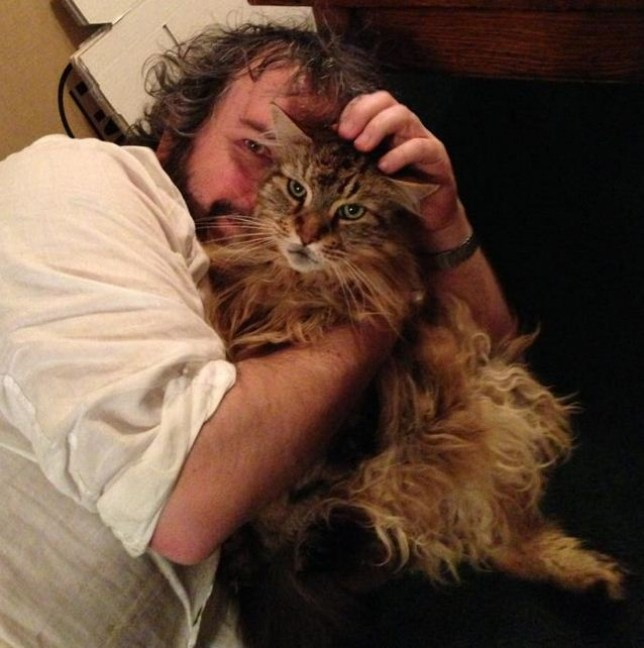 Peter Jackson cuddles up to his cat Mr Smudge (Picture: Peter Jackson/Facebook)