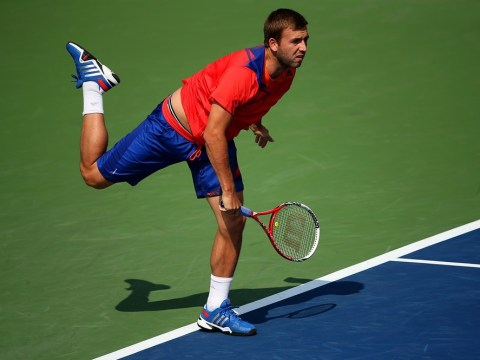 US Open 2013: Dan Evans claims shock win over Bernard Tomic to reach third round