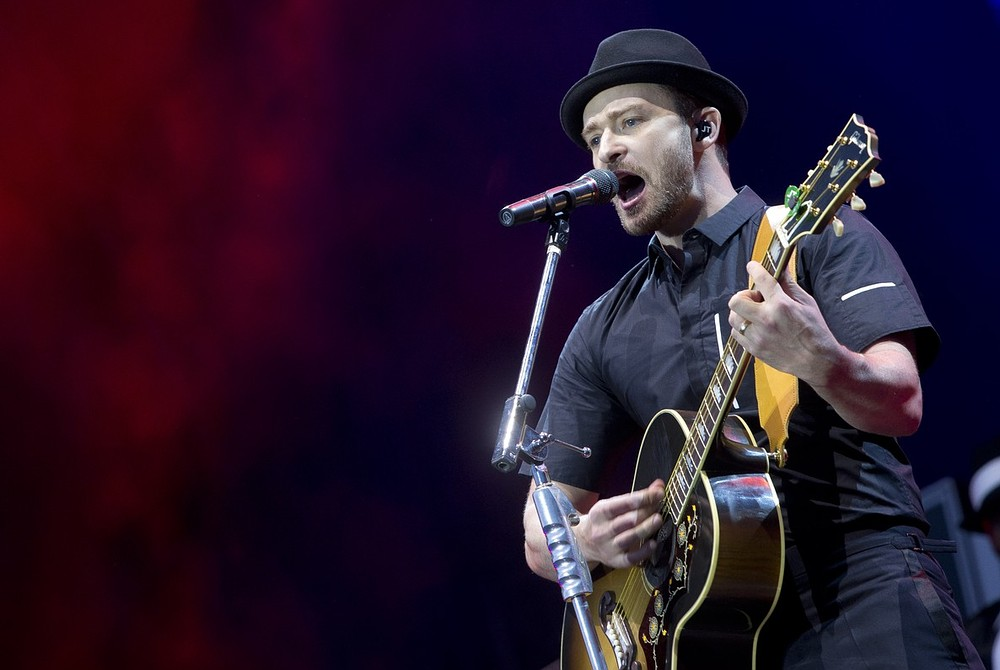 Justin Timberlake performs on stage during the Wireless Festival at the Queen Elizabeth Olympic Park, in east London, Friday, July 12, 2013. This year the festival moves from its usual home of Hyde Park to take place at London's Olympic Stadium. Joel Ryan/Invision/AP