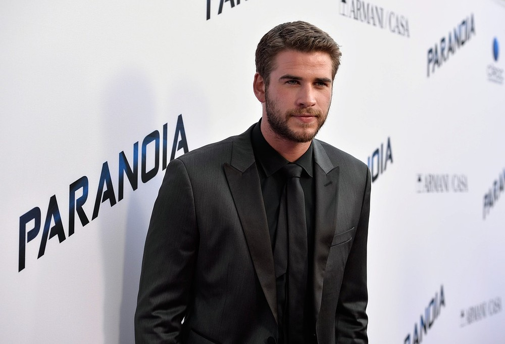 Liam Hemsworth plans to keep his clothes on on Twitter (Picture: Getty)