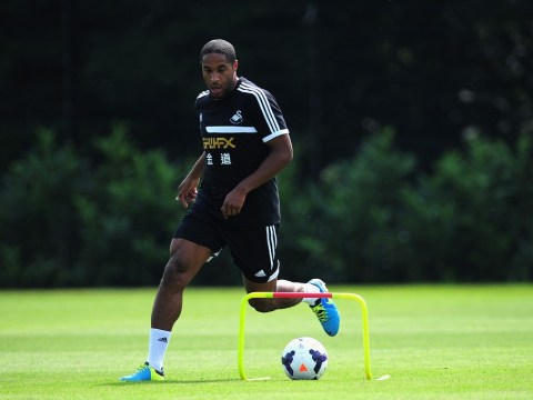 Swansea won't let Ashley Williams and Michu go to Arsenal without a fight