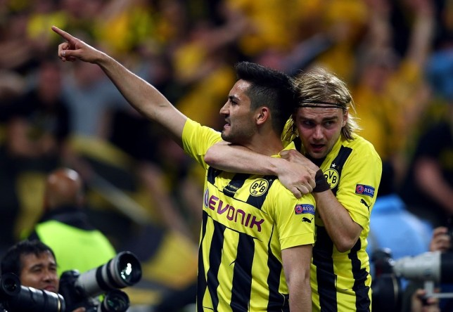 Ilkay Gundogan (left) has been linked with a move to England (Picture: Getty)