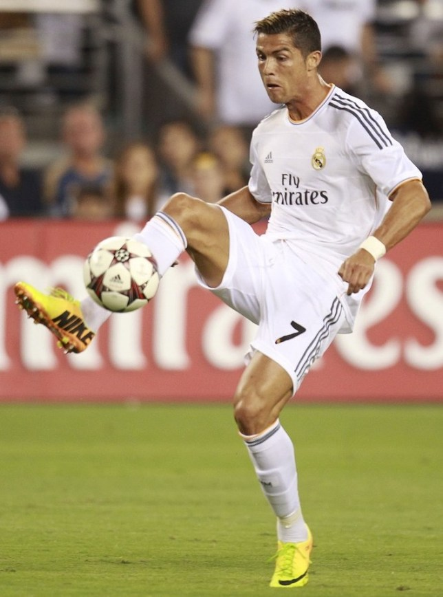 IMAGE DISTRIBUTED FOR GUINNESS INTERNATIONAL CHAMPIONS CUP - Real Madrid forward Cristiano Ronaldo (7) controls the ball against Los Angeles Galaxy during the first half of the Guinness International Champions Cup match on Thursday, Aug. 1, 2013, in Glendale, Ariz. AP Images for Guinness International Champions Cup