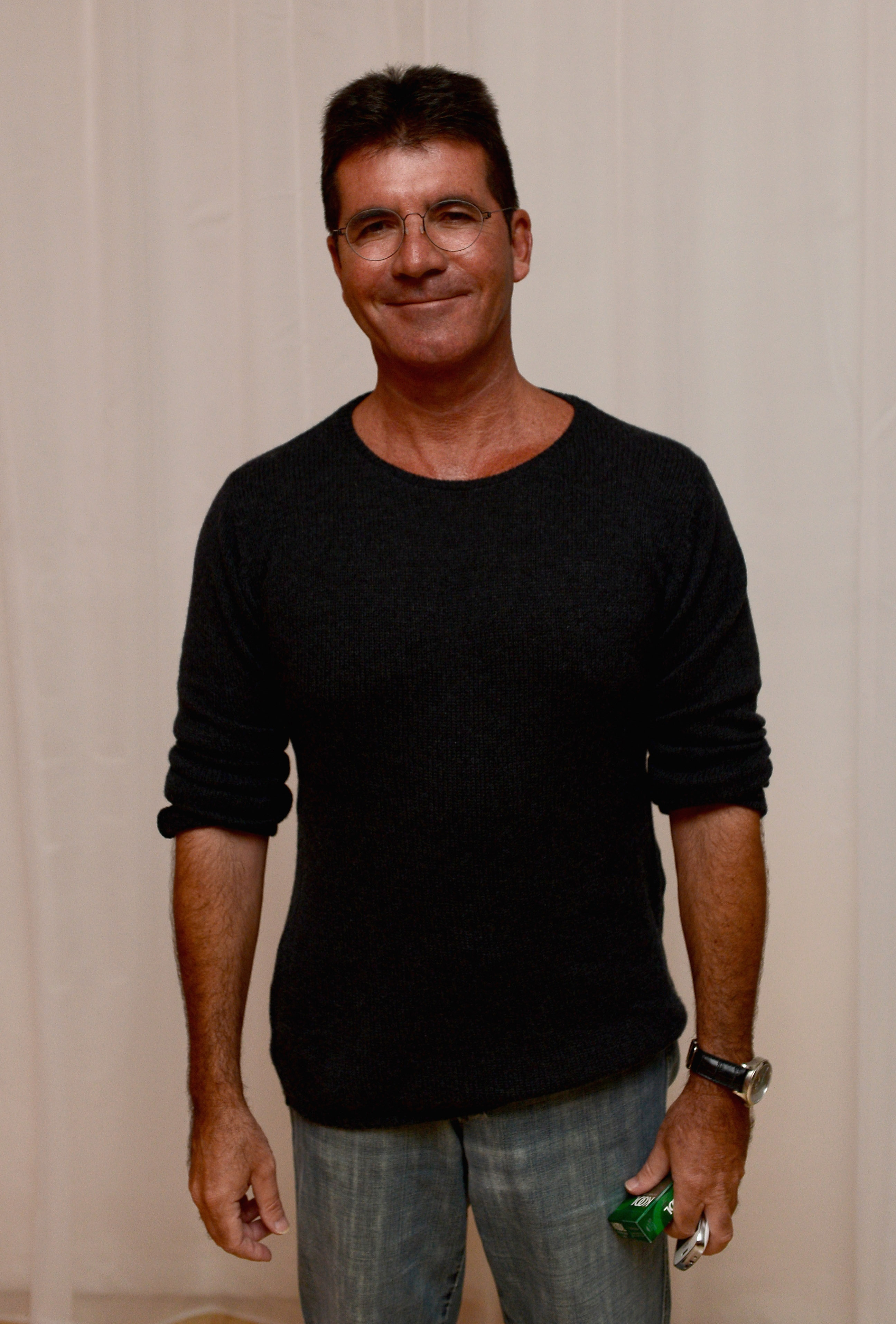 Simon Cowell is thinking about naming his son after himself (Picture: Ian Gavan/Getty Images for Sony Pictures)