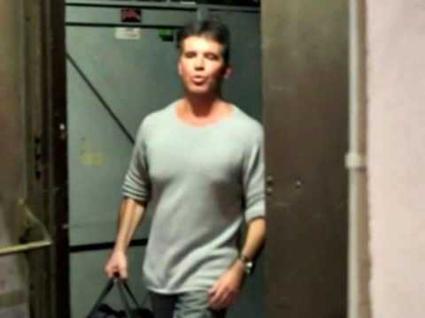 Keeping mum: Simon Cowell makes first public appearance but remains tight-lipped on news he is set to become a father