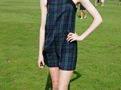 Karen Gillan proudly shows off her shaved head at the polo