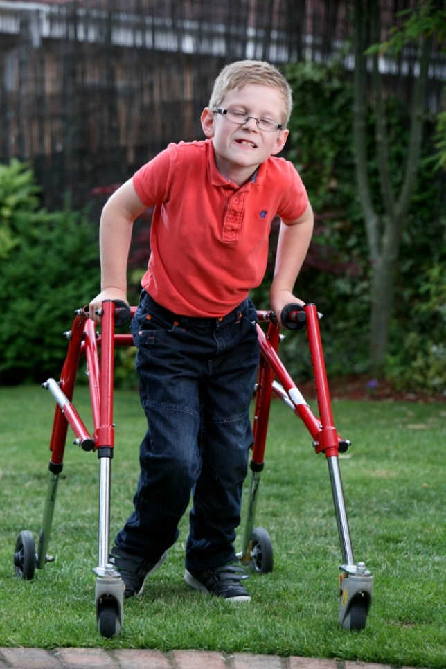 Picture: Lorne Campbell / Guzelian Joseph Hill (8) of Hall Green, Wakefield, West Yorkshire, who has cerebral palsy. His parents have been told they will need to pay £20,000 for an operartion for Joseph. WORDS BY GUZELIAN. PICTURE TAKEN ON SUNDAY 28 JULY 2013