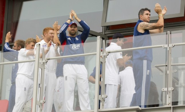England players including Kevin Pietersen, right, and Jonathan Trott, centre, celebrate after their side retained the Ashes as play is abandoned on the final day of the third Ashes Test series cricket match against Australia at Old Trafford cricket ground, Manchester, England, Monday, Aug. 5, 2013. (AP Photo/Jon Super)