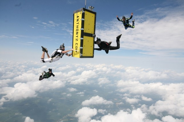 In this photo provided by Skydive Chicago, escape artist Anthony Martin falls while handcuffed and locked inside a box after being dropped from an airplane over Ottawa, Ill., Tuesday, Aug. 6, 2013.  (AP Photo/Courtesy of Skydive Chicago, Joe Silva)