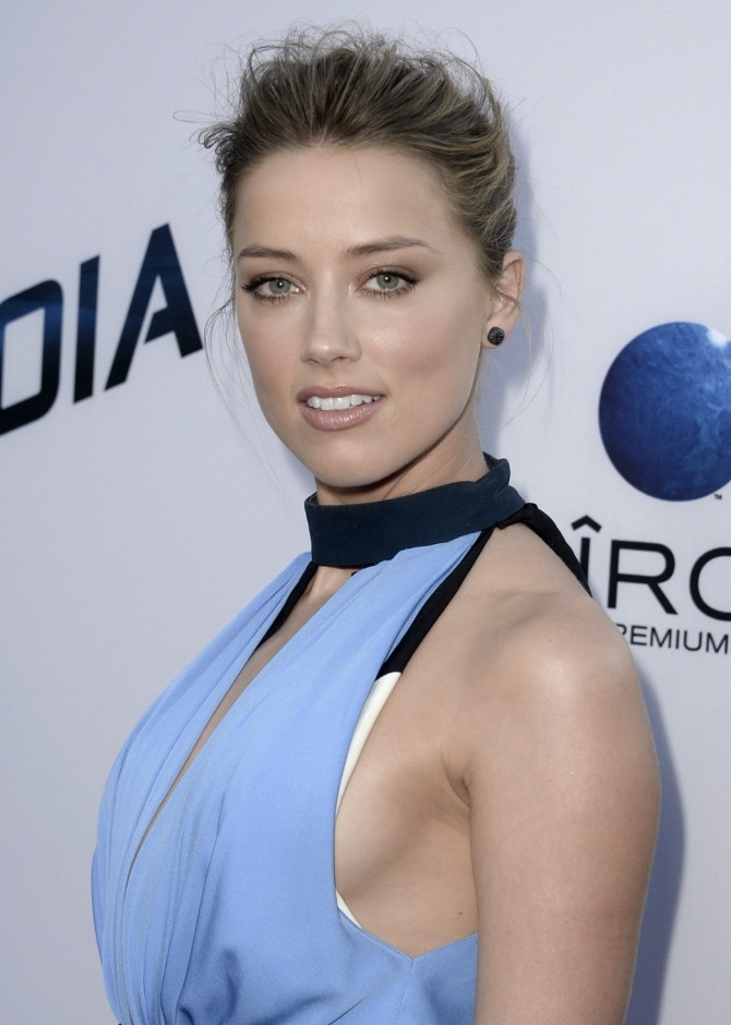 "LOS ANGELES, CA - AUGUST 08: Actress Amber Heard attends the premiere of Relativity Media's ""Paranoia"" at the DGA Theater on August 8, 2013 in Los Angeles, California.  (Photo by Kevin Winter/Getty Images)"