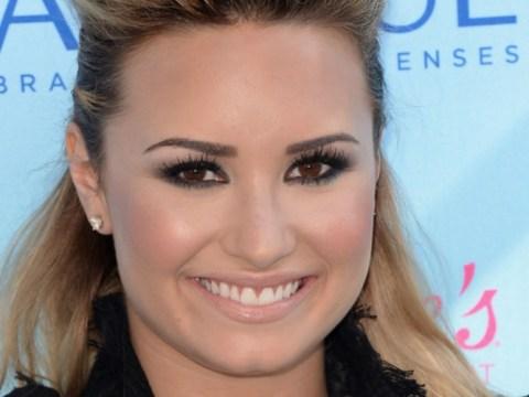 Australian DJ Ruby Rose claims she had a 'lesbian romp' with The X Factor USA judge Demi Lovato