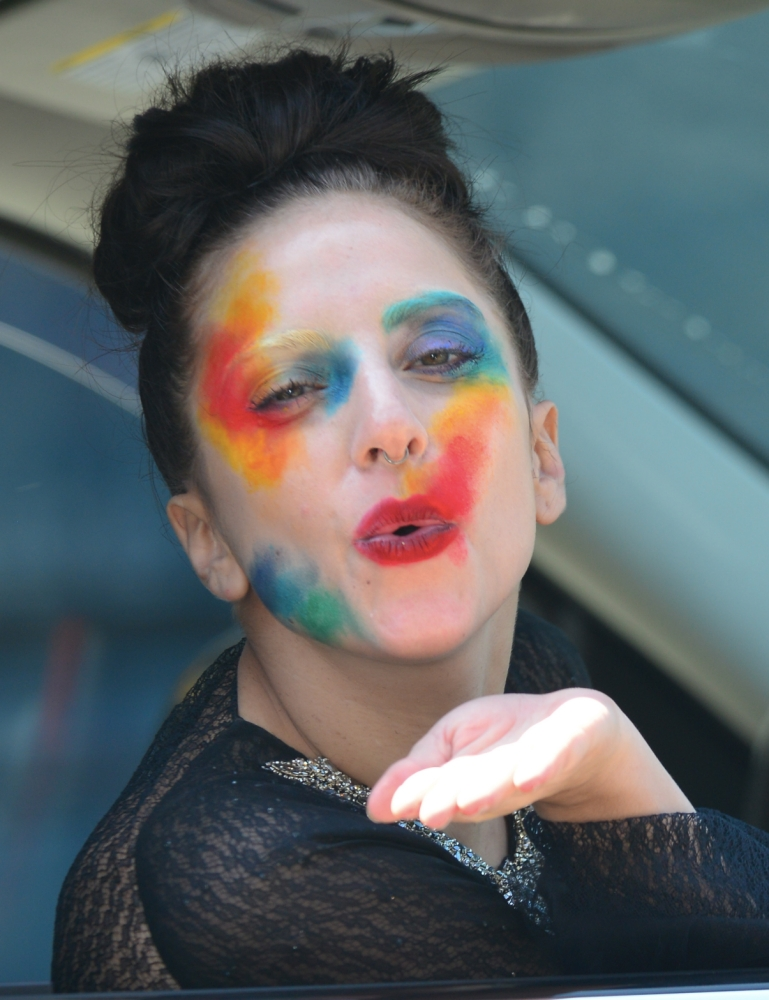 Lady Gaga dons war paint for chart battle with Katy Perry as she urges fans NOT to buy her new single