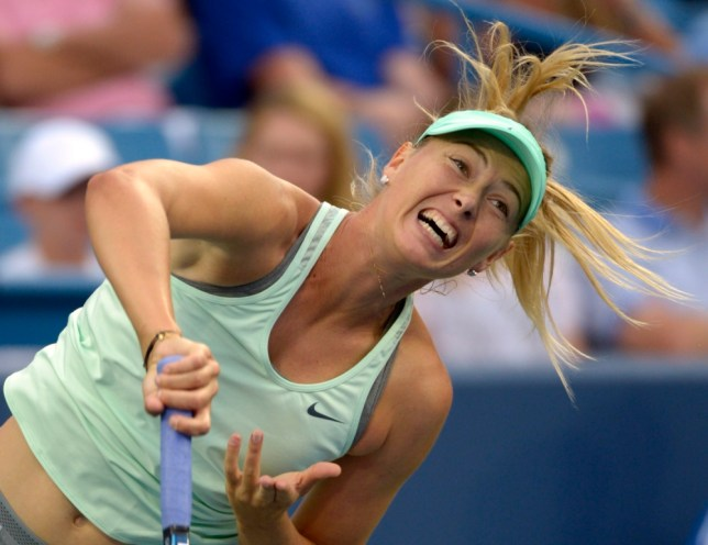 Maria Sharapova, from Russia, serves during a match against Sloane Stephens, from the United States, at the Western & Southern Open tennis tournament, Tuesday, Aug. 13, 2013, in Mason, Ohio. (AP Photo/Michael E. Keating)