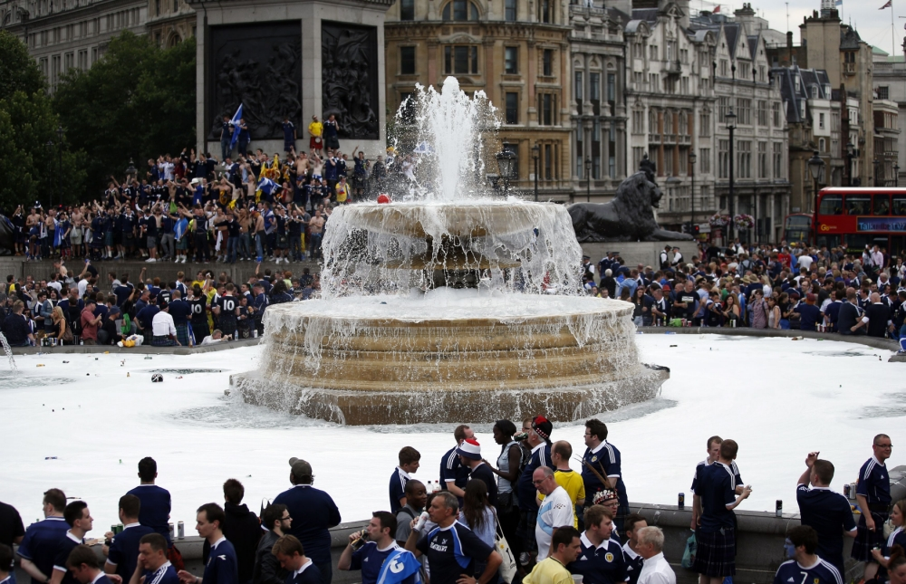 Scottish football fans gather in Trafalgar Square, London, ahead of an international friendly match between England and Scotland at Wembley. PRESS ASSOCIATION Photo. Picture date: Wednesday August 14, 2013. See PA story SPORT Scotland. Photo credit should read: Jonathan Brady/PA Wire