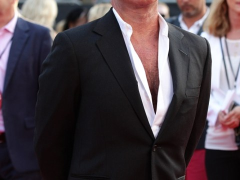 'Proud' Simon Cowell finally confirms impending fatherhood at One Direction's This Is Us premiere