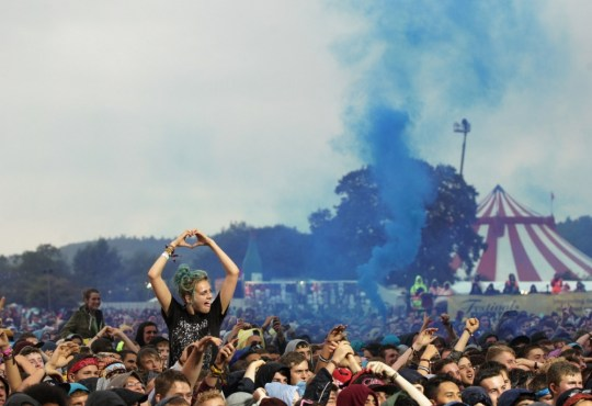 Festival goers watching Earlwolf on Main Stage, during day two of the Reading Festival. PRESS ASSOCIATION Photo. Picture date: Saturday August 24, 2013. Photo credit should read: Yui Mok/PA Wire