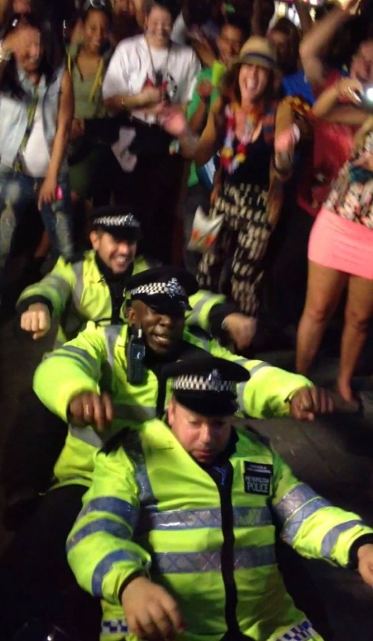 Notting Hill Carnival police delight crowd with impromptu 'row the boat' dance off. Downloaded from http://youtu.be/5-E_tikSXfc  by Richard Taylopr