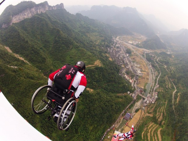 Pic By HotSpot Media -WHEELCHAIR BASEJUMPER - In Pic Canadian Lonnie Bissonnette, 48 throwing himself off the New River Gorge, West Virginia, USA -  These incredible photographs show base-jumper Lonnie Bissonnette, 48, enjoying his passion to the fullest - despite being unable to walk or use his left arm BECAUSE of a previous base jump accident. Stunts include jumping from bridges and being piggy-backed off the edge of a cliff to donning a wing-suit and gliding for hundreds of feet at speeds of up to 80-miles-per-hour before releasing his parachuteSEE COPY and VIDEO - 0121 551 1004