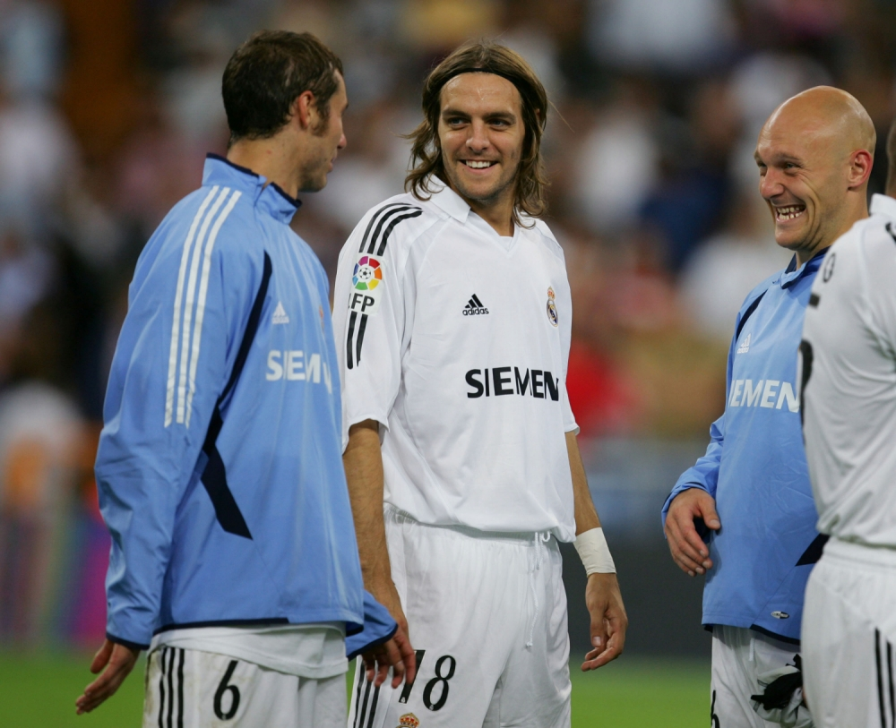 Jonathan Woodgate (centre) chats with Ivan Helguera (left) and Thomas Gravesen after a Santiago Bernabeu Trophy friendly soccer match between Real Madrid and a U.S. Major League Soccer all-star selection at the Bernabeu in Madrid, Spain.