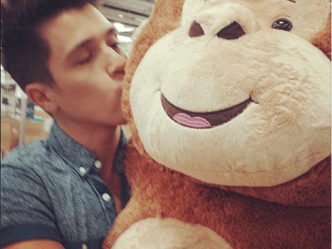 Union J heartthrob JJ Hamblett hugs a giant stuffed toy ahead of individual Twitter excitement