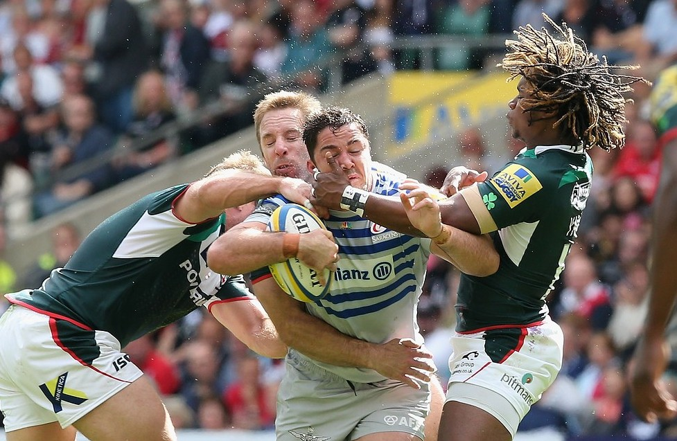 LONDON, ENGLAND - SEPTEMBER 07:  Brad Barritt of Saracens is tackled by Marland Yarde (R) and David Paice during the Aviva Premiership match between London Irish and Saracens at Twickenham Stadium on September 7, 2013 in London, England. Getty Images