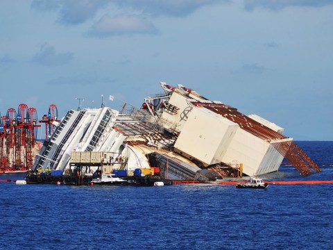 Costa Concordia moves off rocks in 'parbuckling' operation