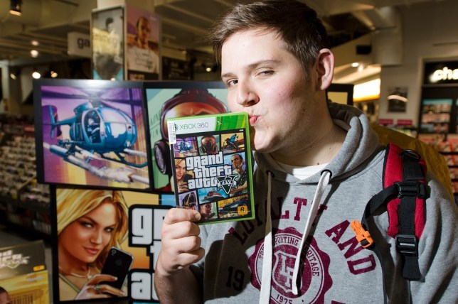Taylor Pelling of Sutton camped outside HMV in London for three days to get his hands on Grand Theft Auto 5 (Picture: AFP/Getty Images)