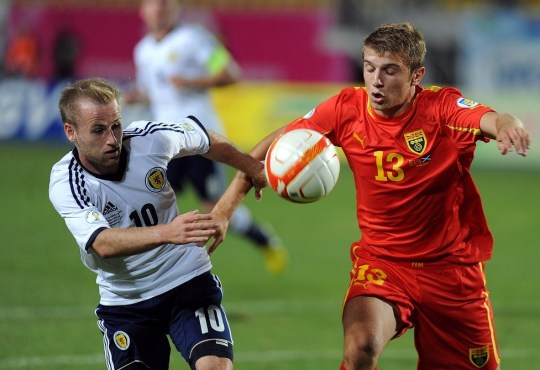 Macedonia's Stefan Ristovski (R) challenges Scotland's Barry Bannan (L) during the 2014 World Cup European zone group A qualifying football match between Scotland and F.Y.R. Macedonia at Filip II Stadium in Skopje on September 10, 2013. AFP/Getty Images