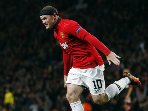 Wayne Rooney wants to keep playing as he speaks of pride at making Manchester United 200 club