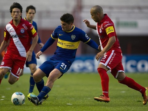 He must be off his head! Argentine footballer loses three teeth in head-first tackle