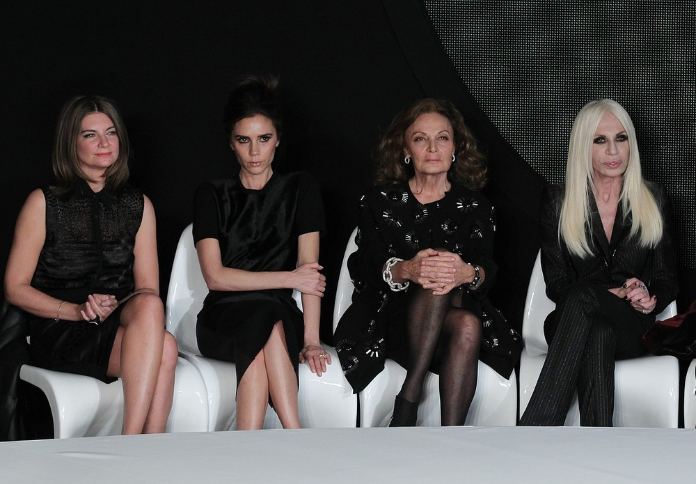 Natalie Massenet sits alongside Victoria Beckham at the International Woolmark Prize during London Fashion Week in February 2013 (Picture: PA Wire/Press Association Images)