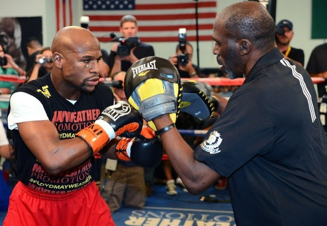 LAS VEGAS, NV - AUGUST 28:  Boxer Floyd Mayweather Jr. (L) works out with his trainer and uncle Roger Mayweather at the Mayweather Boxing Club on August 28, 2013 in Las Vegas, Nevada. Mayweather will face Canelo Alvarez in a WBC/WBA 154-pound title fight on September 14 in Las Vegas. Getty Images