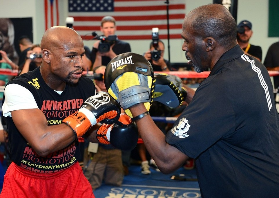 Brit fan: Mayweather works out with his trainer and uncle Roger (Picture: Getty Images)