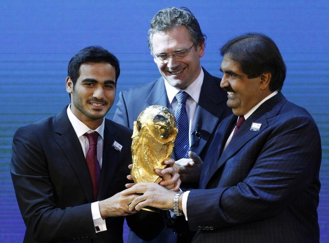 Qatar's 2022 World Cup bid chairman Sheikh Mohammed bin Hamad bin Khalifa al-Thani, FIFA Secretary-General Jerome Valcke and Qatar's Emir Sheikh Hamad bin Khalifa al Thani (L-R) hold a copy of the World Cup after the announcement that Qatar is going to be host nation for the FIFA World Cup 2022 (picture: REUTERS)