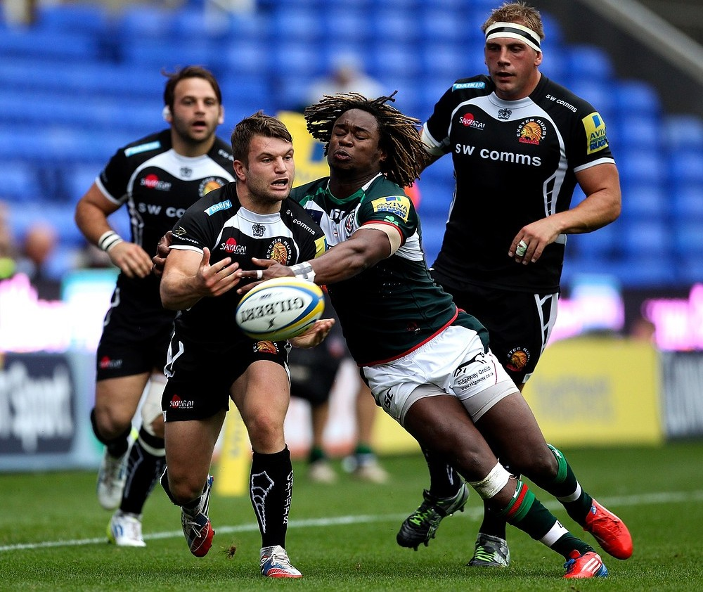 READING, ENGLAND - SEPTEMBER 21: Phil Dolmann of Exeter passes the ball ahead of the tackle of Marland Yarde of London Irish during the Aviva Premiership match between London Irish and Exeter Chiefs at Madejski Stadium on September 21, 2013 in Reading, England. Getty Images