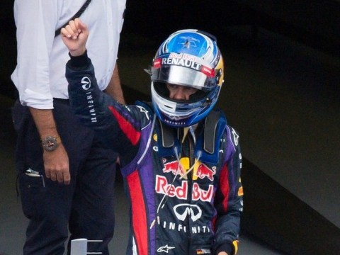 Sebastian Vettel on top of the world after easing to victory at the Singapore Grand Prix