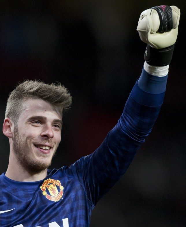 Manchester United's goalkeeper David De Gea celebrates as his team wins their 20th English Premier League title after their 3-0 win over Aston Villa in their soccer match at Old Trafford Stadium, Manchester, England, Monday April 22, 2013. AP