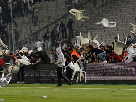 Turkish football fans go on the rampage brandishing garden furniture as weapons