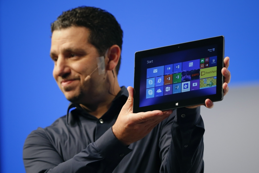 Panos Panay, Microsoft Surface general manager, holds up the Microsoft Surface Pro 2 during the launch of their Surface 2 tablets in New York September 23, 2013. REUTERS/Shannon Stapleton (UNITED STATES - Tags: SCIENCE TECHNOLOGY BUSINESS)