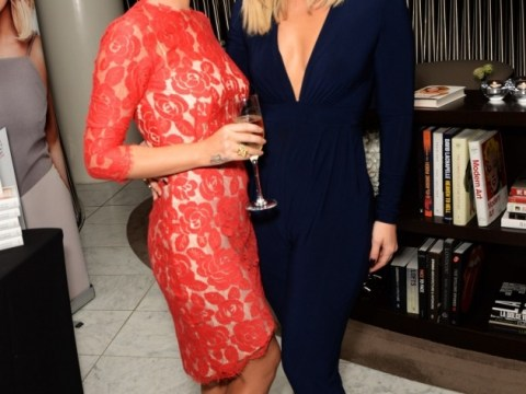 Lady in red: Cheryl Cole outshines Kimberley Walsh at her book launch