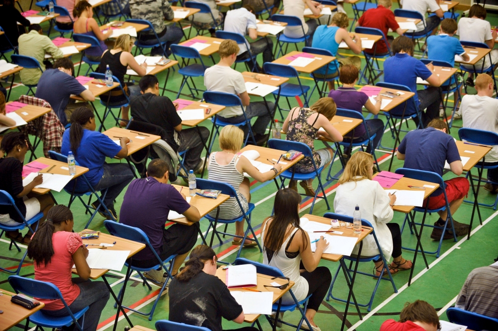 """File photo dated 24/05/10 of students sitting an exam as teenagers' speaking and listening abilities will no longer count towards their final GCSE English grades, despite widespread opposition to the move. PRESS ASSOCIATION Photo. Issue date: Thursday August 29, 2013. England's exams regulator Ofqual has confirmed it is pushing ahead with plans to strip the key skills out of the qualifications amid concerns that assessments, which are carried out by teachers, are not being conducted and marked consistently across all schools. Chief regulator Glenys Stacey admitted that the decision would be """"unpopular"""" with many teachers, but insisted it was necessary because the current system is unfair. See PA story EDUCATION English. Photo credit should read: Ben Birchall/PA Wire"""