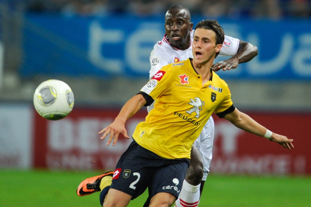 Sochaux' French defender Sebastien Corchia (Front) vies with Ajaccio's Franco Malian midfielder Sigamary Diarra during the French L1 football match between Sochaux (FCSM) and Ajaccio (ACA) on August 31, 2013, at the Auguste Bonal Stadium in Montbeliard, eastern France. AFP PHOTO / SEBASTIEN BOZONSEBASTIEN BOZON/AFP/Getty Images