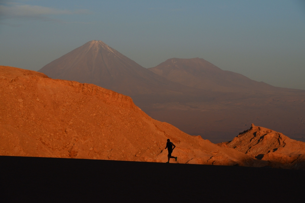 """Runners run a test event on the route of the inaugural """"Volcano Marathon"""" which will take place November 14 2013 in a volcanic region of The Atacama Desert in Chile at an average altitude of 4,000 metres. Photo by Mike King"""