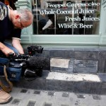A camera man films broken slates outside a cafe in London September 3, 2013. Local media reported the tiles had shattered from sunlight reflected by the Walkie Talkie tower in London. The developers of a London skyscraper that reflects sunlight at such intense levels that it warped panels and melted mirrors on a parked car will not need to break the bank to fix the problem, a project source told Reuters.  REUTERS/Stefan Wermuth (BRITAIN - Tags: BUSINESS  SOCIETY ENVIRONMENT REAL ESTATE)