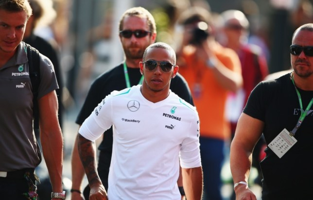 MONZA, ITALY - SEPTEMBER 07:  Lewis Hamilton of Great Britain and Mercedes GP arrives in the paddock prior to the final practice session before qualifying for the Italian Formula One Grand Prix at Autodromo di Monza on September 7, 2013 in Monza, Italy.  (Photo by Clive Mason/Getty Images)